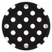 Svarta papperstallrikar med vita prickar