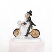 Bryllupsfigur med brudepar på cykel